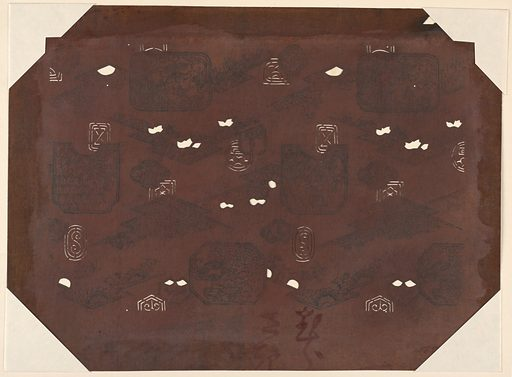 Many of these Japanese motifs originated from China. During ceremonial occasions, in Japan, people wore interlaced circles, medallions, and other abstract designs. This stencil has ink stamps of other designs that would be carved into a different stencil to allow for the use of multiple colors. The lower half of the stencil contains Japanese characters. Made in: Japan. Date: 1820s. Record ID: chndm_1948-128-57.