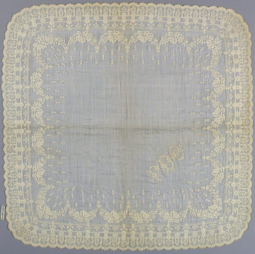 """White linen handkerchief with elaborate embroidered borders. Buttonholed scalloped edge with shield-shaped sections framing minute embroidered flowers. Above are other border designs and festoons of small flowers. Large corner initial embroidered in white: """"P.D.O."""". Made in: Belgium or France. Date: 1840s. Record ID: chndm_1951-60-2."""