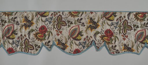Valence with scalloped border in floral printed cotton with the edges bound in blue tape. The pattern has natural-size flowers and leaves in violet, blue, green, yellow, red, and brown on a picotage ground in brown on white. Made in: Augsburg, Germany. Date: 1820s. Record ID: chndm_1952-105-1.