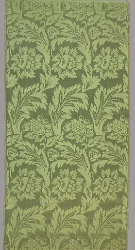 Apple-green satin damask woven with feathery serrated leaves forming parallel serpentine trails from which spring peonies and other blossoms in lateral rows. Striped pink and yellow selvages. Made in: Italy. Date: 1700s. Record ID: chndm_1952-166-45-a_d.