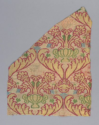 White silk warp. Wefts used together, of white, red, yellow, blue, green and pink silks and flat strips of silver. Background white with incomplete design of ogives formed by a large leaves with crowns at intersections, each ogive enclosing an urn with flowers. Clear colors appear only in narrow outlines of design where extra wefts are floated out. In rest of fabric white warps appear over mixed wefts thus dulling colors. Made in: Italy. Date: 1500s. Record ID: chndm_1896-1-125.