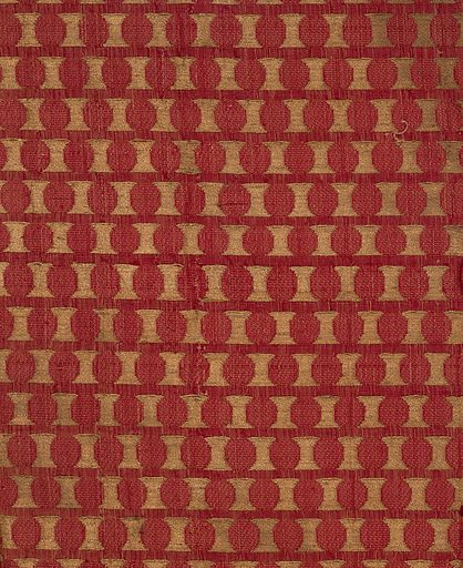 Deep red velvet with offset repeat pattern of gold disks. The foundation is plain weave formed by a red silk warp and tan silk weft; the supplementary warp pile is red silk. The velvet pile is voided in the areas where the coin dots appear, and supplementary gold wefts are floated in pairs to the surface in these areas, bound in twill with the secondary ivory warp. Made in: Iran. Date: 1100s. Record ID: chndm_1902-1-385.