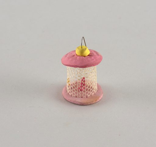 Birdcage of white mesh with pink candy base and top. Made in: USA. Date: 1890s. Record ID: chndm_1956-32-50.