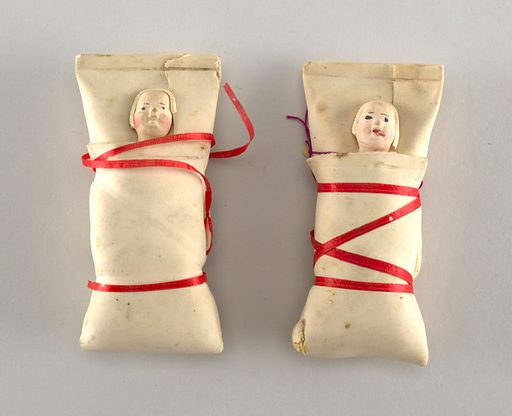 Swaddled babies, tied with red ribbon. Made in: USA. Date: 1890s. Record ID: chndm_1956-32-60-a_b.