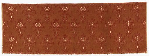 Upholstery weight cotton velvet with a design of regularly spaced symmetrical floral sprays in two shades of coral with touches of white where the backing fabric shows through. Made in: possibly USA. Date: 1820s. Record ID: chndm_1957-180-25.