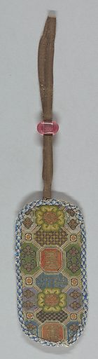 One side of an embroidered spectacle case with geometric and floral designs in polychrome silks. Edged with blue braid and fitted at the top with silk ribbon and a pink bead slide. Made in: China. Date: 1800s. Record ID: chndm_1939-37-17.