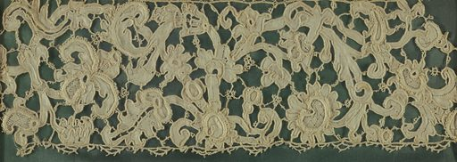 Venetian point in low relief with various needlemade stitches and picots. Design of scrolling stem with leaves and flowers. Made in: Venice, Italy. Date: 1600s. Record ID: chndm_1939-66-2-b.