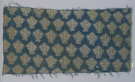 All-over pattern of small-scale, stylized floral forms brocaded in white silk and silver thread on a ground of blue satin. Satin ground originally shot through with extra silver (flat metal strips) threads; now almost entirely worn away. Made in: Italy. Date: 1700s. Record ID: chndm_1943-46-11.