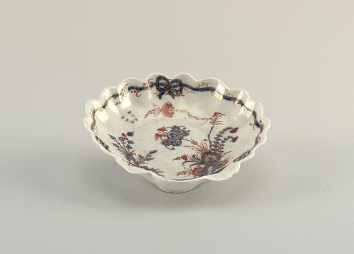 Shell form, decorated in Chinese style with carnations, in red and blue with gilt highlights, on a blue-grey glaze. Made in: Italy. Date: 1770s. Record ID: chndm_1938-57-657-e.