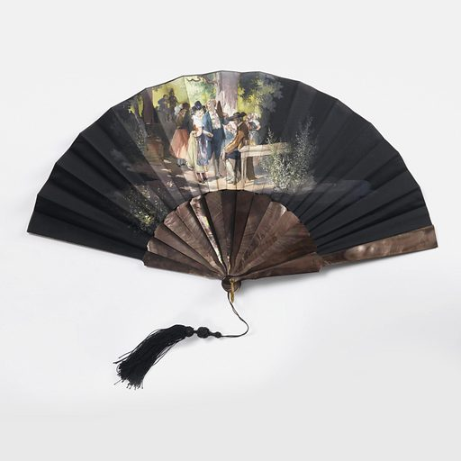 Pleated fan. Leaf and obverse are black taffeta painted with scene of a party under trees with a standing young couple in front of a seated man in the foreground. Reverse is plain. Sticks and guards are plain dark-colored mother-of-pearl with fancy black silk tassel. Made in: France. Date: 1900s. Record ID: chndm_1942-34-4-a.