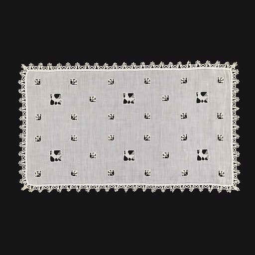 Rectangular panel of linen ornamented with small squares containing leaves worked in needle lace and larger squared containing birds worked in needle lace, edged with narrow bobbin lace. Made in: USA. Date: 1900s. Record ID: chndm_1943-44-7.