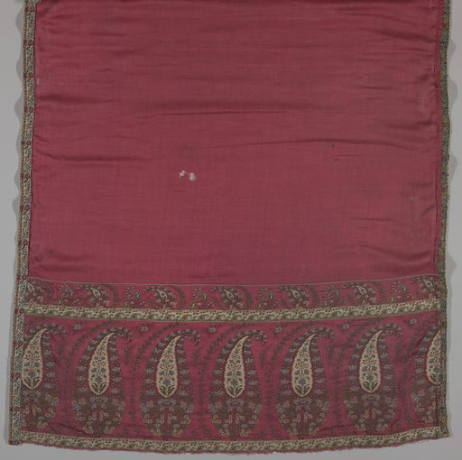 Paisley design on red cloth. Six large cone motifs on both ends of shawl. Plain red silk has been stitched to the paisley borders. A brocaded band is stitched all around the shawl. Light blue, green, dark brown, and red are the predominant colors. Made in: France. Date: 1800s. Record ID: chndm_1944-68-1.