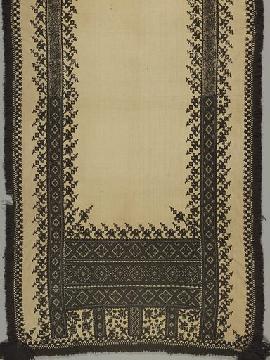 Oblong panel of heavy cream white hand-woven linen embroidered in black wool and trimmed with fringe of black wool and black tassels at each corner. Borders at side and deep border at end, with a highly stylized plant form, detached and placed at a slant, above borders of geometric forms. Cross and satin stitch. Made in: Spain. Date: 1700s. Record ID: chndm_1950-34-3.