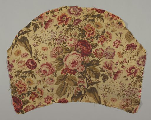 Fragment cream colored wool, twill weave; semicircular in shape, printed in shades of red, yellow, olive green, drab, violet. Naturalistic cluster of roses, tulips, etc. Probably roller print with overprint by block. Left selvage present. Made in: Europe. Date: 1820s. Record ID: chndm_1953-22-1.