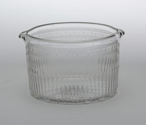 Basin shaped with vertical impressions along lower half, engraved asterisks near upper rim, with two spouts. Made in: England. Date: 1800s. Record ID: chndm_1968-160-3-e.