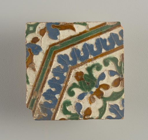Moulded in low relief, with white, blue, green and brown glazed, forming an octagonal motif, with conventionalized floral and foliate forms. Made in: Andalusia, Spain. Date: 1600s. Record ID: chndm_1935-16-1-c.