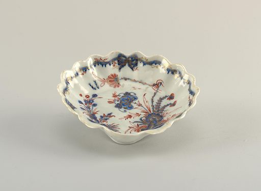 Shell form, decorated in Chinese style with carnations, in red and blue with gilt highlights, on a blue-grey glaze. Made in: Italy. Date: 1770s. Record ID: chndm_1938-57-657-d.