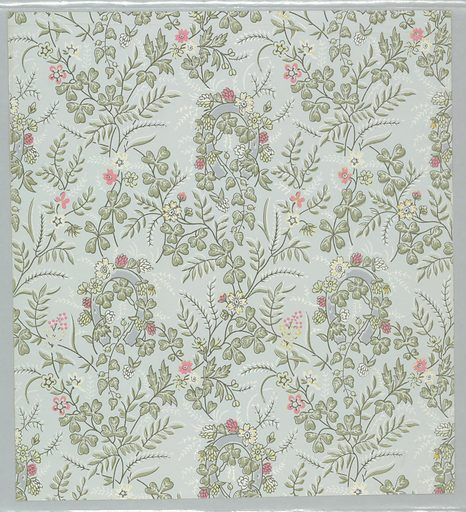 Rustic pattern of sprigs of flowering vines floating freely or wrapped around horseshoes; single-motif diamond-shaped repeat in off-set rows; cream and pink flowers, light green foliage, and pale blue horseshoes; black outlining throughout; ground a very pale blue. Made in: USA. Date: 1880s. Record ID: chndm_1970-26-4-cy.