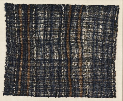 Carrying cloth of loosely woven, crepe-spun, indigo-dyed cotton, with stripes of brown and natural off-white cotton. Made in: Peru. Date: 1400s. Record ID: chndm_1948-122-3.