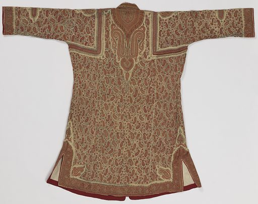 Robe open down center front with two purple frog style closures at chest. Robe has long sleeves and slightly flared skirt with short side slits. Robe is pieced together, with braid embellishment along seam. Overall paisley and vine motifs worked in red, greens, blues, and yellow on a white background. Lined in beige silk. Made in: India. Date: 1800s. Record ID: chndm_1949-107-1.
