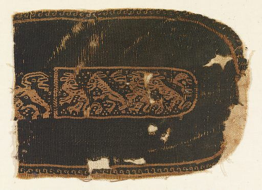 Shape with one oval end. In the center a procession of spitited animals. Record ID: chndm_1902-1-17.