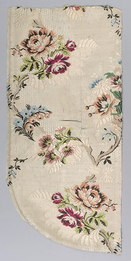 Serpentine pattern of polychrome branches on off-white. Many tears in the fabric. Date: 1800s. Record ID: chndm_1902-1-941.