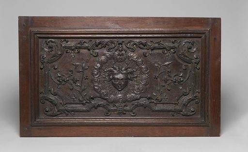 Panel with head in center, surrounded by sun-like rays; foliate patterns around. Made in: France. Date: 1700s. Record ID: chndm_1908-24-8-a.