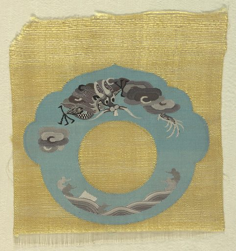 Uncut pieces for costume accessories have a yellow ground with a lobed blue ring containing a dragon, clouds and waves in many shades of gray. Made in: China. Date: 1910s. Record ID: chndm_1956-195-1-e.