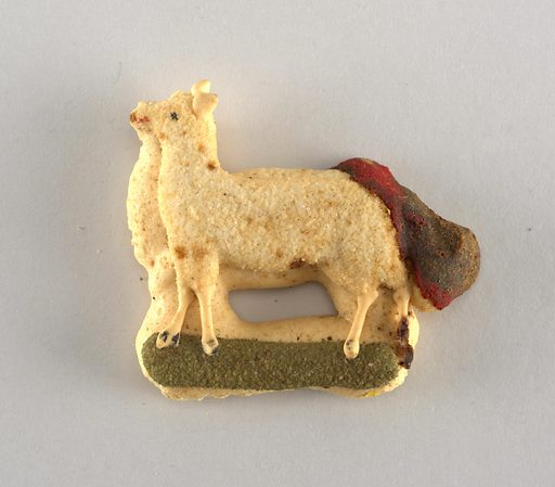 Lamb-like animal, standing on green grass, in relief. Date: 1890s. Record ID: chndm_1956-32-37.