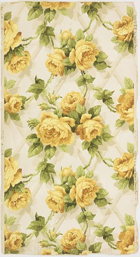 """On silvery white ground large yellow roses on pale gray trellis. Straight repeat, drop match. Printed in right selvedge: """"5882 D E E The Robert Graves Co."""". Made in: New York, New York, USA. Date: 1900s. Record ID: chndm_1956-42-98."""