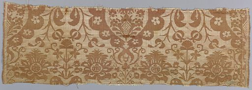Symmetrical vertical repeat of large stylized decorated palmette head flanked above and below by pairs of ogival shapes formed by long, lobed leaves with flowers curving from either side of the base. Straight flower spray rises from the top. Two broad white warp twill selvages with narrow outer edges of plain weave. Made in: Italy or China. Date: 1700s. Record ID: chndm_1953-162-78-a_b.