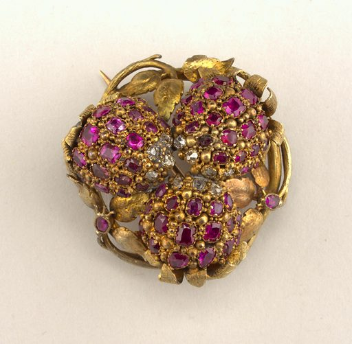 In the form of three berries, with gold leaves and stems. Eleven diamonds, fifty-eight rubies. One loose berry was repaired in 1957 (see object card for details). Made in: France. Date: 1820s. Record ID: chndm_1953-178-133.