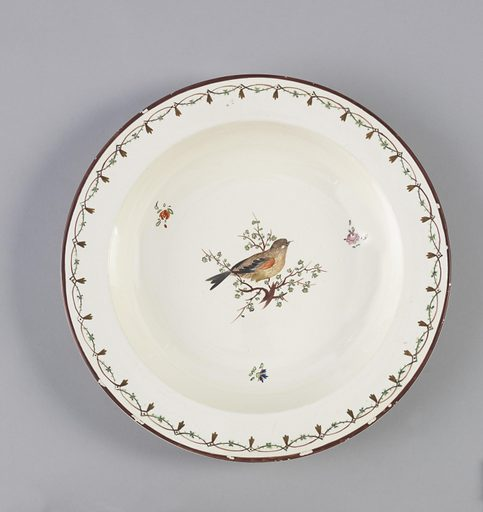 Flat, straight marly, decorated with overglaze maroon edge, maroon and green foliated and interlaced lines. In center of (a), warber-like bird with red wing, turned right; (b) with purple wing, turned left. Made in: England. Date: 1770s. Record ID: chndm_1955-37-1-b.