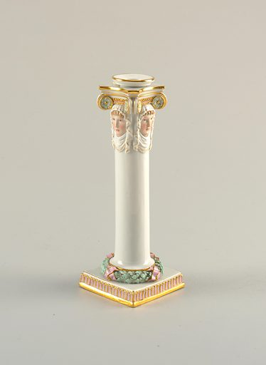 Each candlestick is composed of a round white column on a square plinth, and with a capital of four female heads with draped head-dresses in nature colors, under white and gold Ionic scrolls. Wreath of light green oak leaves bound with lavender-pink ribbons forms the base of column, and plinth has a border on its vertical face of flutings of the same color and gold band. Scrolls contain light green rosettes, with the same fluting motif in place of dentils. Gold edges and lines throughout. Separate candle insert. Date: 1800s. Record ID: chndm_1931-84-18-aa_bb.