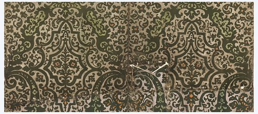 Similar wallhanging used in two rooms in Winterthur Museum, Delaware (1955). Has been folded under along top and cut to fit about a ceiling beam. Has been moth-eaten, and perforated with nail holes. Small stylized floral motif set within tracery, printed in green flock and orange pigment, on metallic gold color ground. Made in: England. Date: 1690s. Record ID: chndm_1938-44-1.