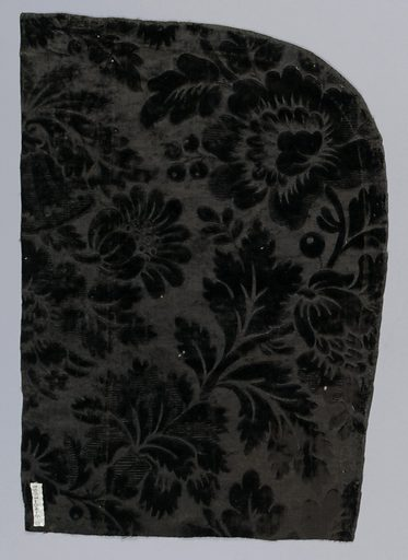 black figured velvet [probably dyed] – design showing all-over floral designs – selvage present. Made in: France. Date: 1800s. Record ID: chndm_1961-84-6-a_b.