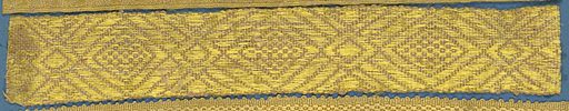 Yellow trimming in a design of large lozenges connected by smaller ones. Made in: France. Date: 1800s. Record ID: chndm_1909-2-127.