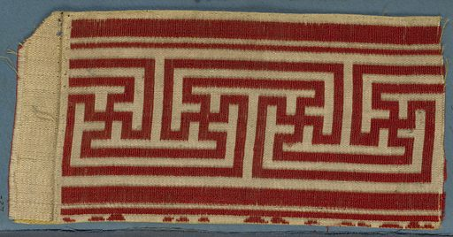 Trimming fragment in a design of red fretwork on a yellow ground. Made in: France. Date: 1800s. Record ID: chndm_1909-2-27.