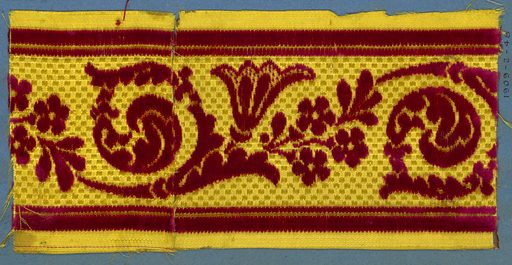 Trimming fragment in a design of flowers sprays and scrolling leaves in red cut velvet on a yellow checkerboard ground. Made in: France. Date: 1800s. Record ID: chndm_1909-2-48.