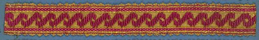 Trimming fragment in a design of crossing ribbons in red on a yellow ground with red stripes; picot edges. Made in: France. Date: 1800s. Record ID: chndm_1909-2-69.