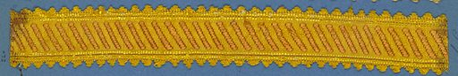 Trimming fragment with a design of diagonal brown bands on a yellow ground; picot edges. Made in: France. Date: 1800s. Record ID: chndm_1909-2-72.