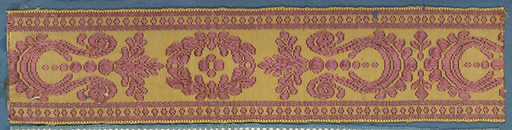 Trimming fragment in a design of alternating ornaments comprised of leaves, scrolls and dots in mauve on a yellow ground. Made in: France. Date: 1800s. Record ID: chndm_1909-2-81.