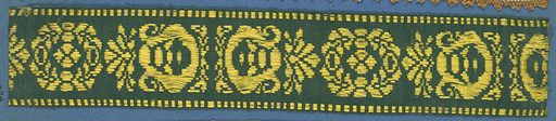Trimming fragment in a design of alternating ornaments comprised of leaves, scrolls and dots in yellow on a green ground. Made in: France. Date: 1800s. Record ID: chndm_1909-2-84.