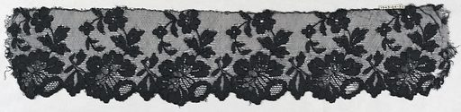 Black lace border with scalloped edge formed by flowers with a curving stem with flowers and leaves rising from each border flower. Made in: Spain. Date: 1800s. Record ID: chndm_1943-24-3-a_b.