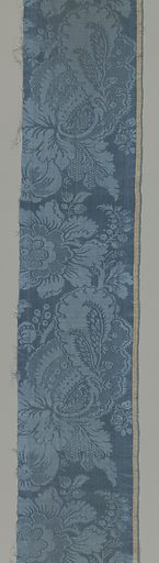 Fragments of a chasuble made from tan and blue damask with a baroque-style pattern. Made in: possibly France. Date: 1800s. Record ID: chndm_1943-43-84-e_f.