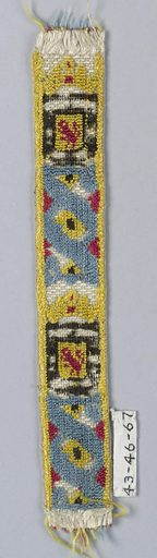Crowned shield showing a lion rampant, red, yellow, and black; alternating with an ornament composed of interlacing band in blue with dots in red and yellow. Made in: Spain. Date: 1800s. Record ID: chndm_1943-46-67.