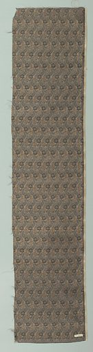Repeats of lotus and other indistinct ornaments filled with fancy weave patterns – the satin backgound is black – wefts are light blue and rose tan. Made in: Japan. Date: 1800s. Record ID: chndm_1944-18-25.