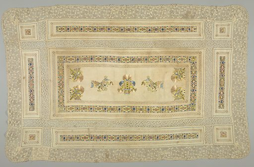 Central panel has embroidery in design of crowned birds on either side of a basket of flowers. Carnation ornaments in corners with borders of stylized flowers and drawn work. Made in: Spain. Date: 1800s. Record ID: chndm_1944-71-2.