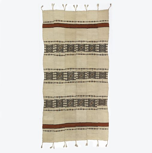 Panel composed of six strips stitched together, fringed on two warp ends. Red stripes at top and bottom with three bands between patterned with triangle and diamond forms, in black, yellow and red on an undyed wool ground. Made in: Sudan. Date: 1800s. Record ID: chndm_1944-87-2.