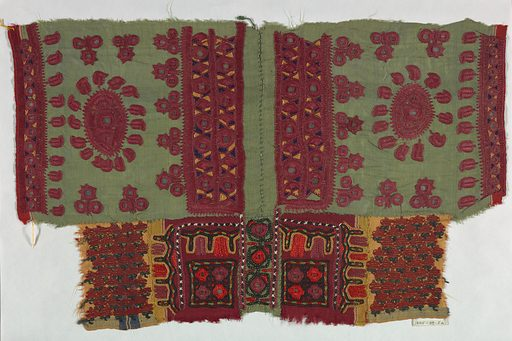 Fragments of green, yellow and red silk pieced together and embroidered in a stylized design of geometric and floral motifs. Made in: India. Date: 1800s. Record ID: chndm_1945-39-5-a.